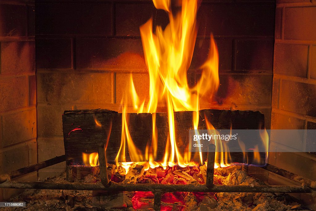 cozy blazing fire in fireplace : Stock Photo