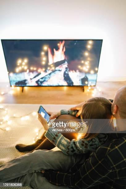 cozy caucasian couple celebrate the holidays in quarantine,lleida,spain - ナイトイン ストックフォトと画像
