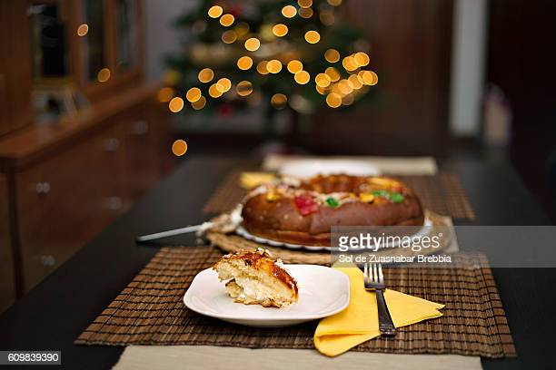 Cozy Christmas. A slice of Christmas fruitcake on a table ready to be eaten