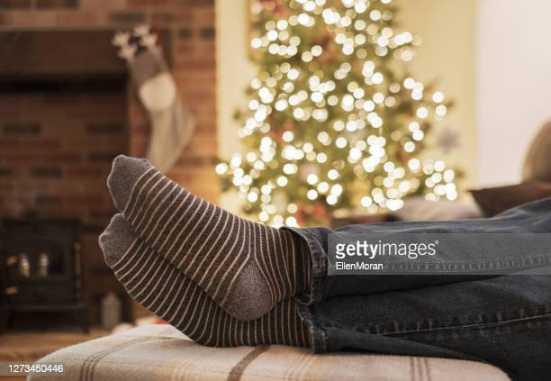 cozy christmas - men wearing stockings stock pictures, royalty-free photos & images