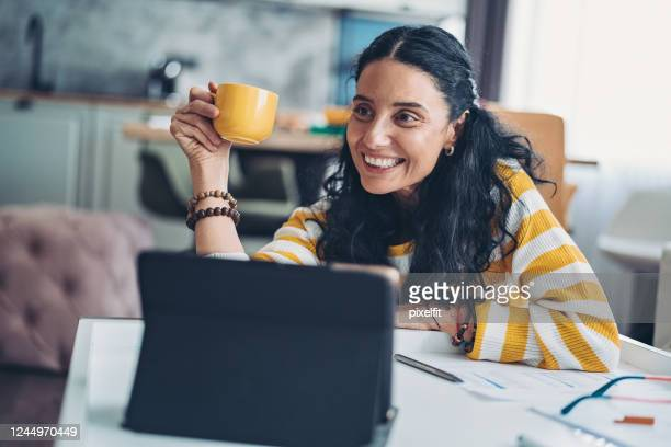 cozy communication form home - candid forum stock pictures, royalty-free photos & images