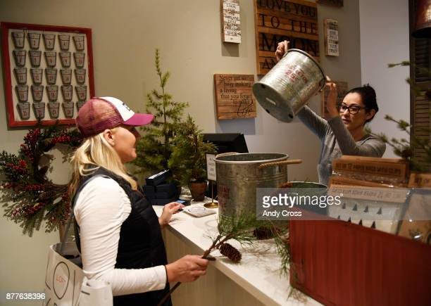 Cozy Cottage employee Felicia Gutierrez right helps customer Kristen Johnson left at the checkout counter at Cozy Cottage in the Cherry Creek Mall...