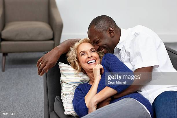 Cozy couple lying on couch