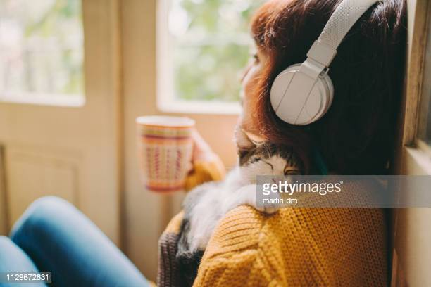cozy home - listening stock pictures, royalty-free photos & images