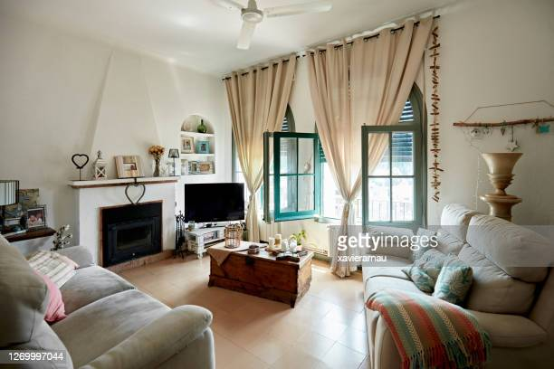 cozy living room in neutral palette with open windows - two seater sofa stock pictures, royalty-free photos & images