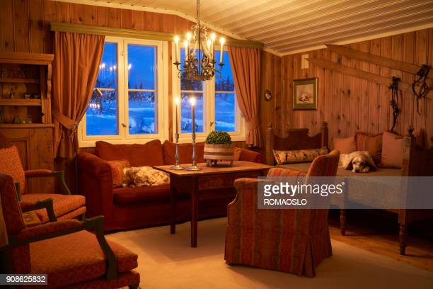 cozy mountain cabin interior with candlelight, oppland county norway - log cabin stock pictures, royalty-free photos & images