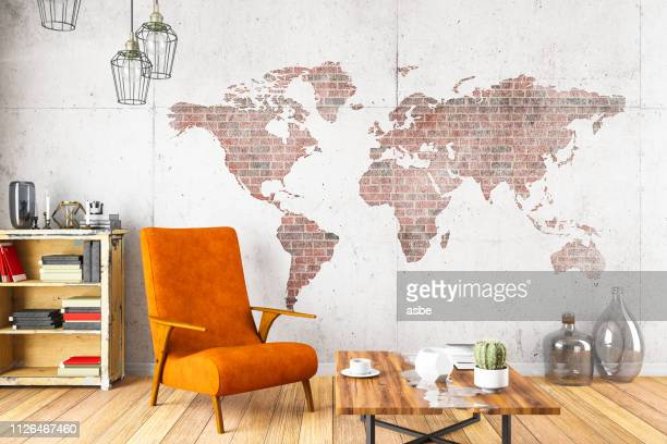 cozy room with world map - world map stock photos and pictures