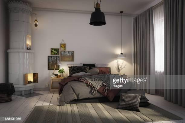 gezellige scandinavische slaapkamer - slaapkamer stockfoto's en -beelden