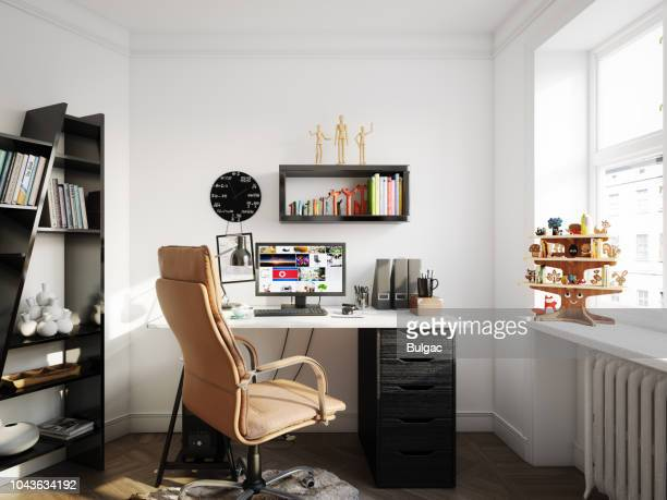 cozy scandinavian style home office - wall clock stock photos and pictures