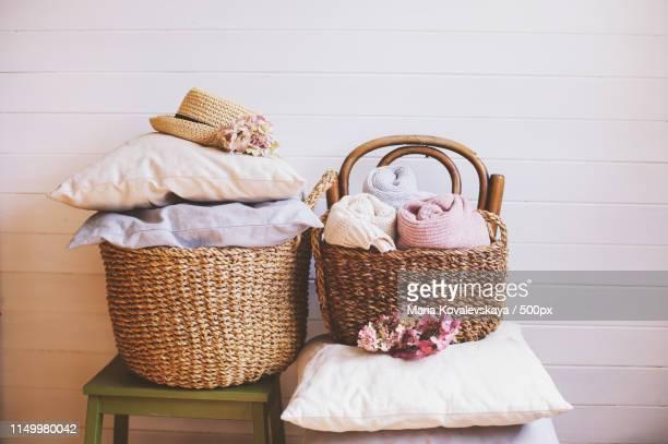 Cozy Still Life Interior Details Organizing Clothes In Wicker Backets, Seasonal Wardrobe And