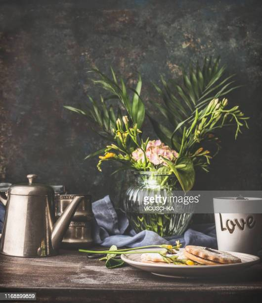 cozy still life with vintage tea set, cookies and flowers bunch in vase - still life stock pictures, royalty-free photos & images