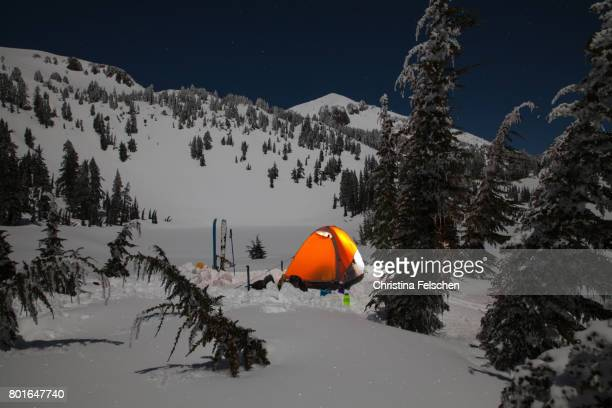 cozy tent night under a snowy mountain - christina felschen stock photos and pictures