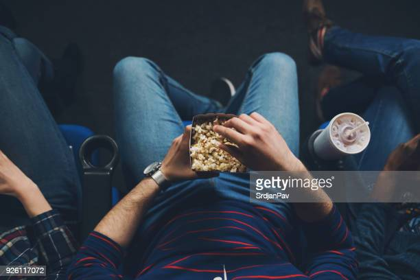 cozy time at the cinema - adult film stock photos and pictures