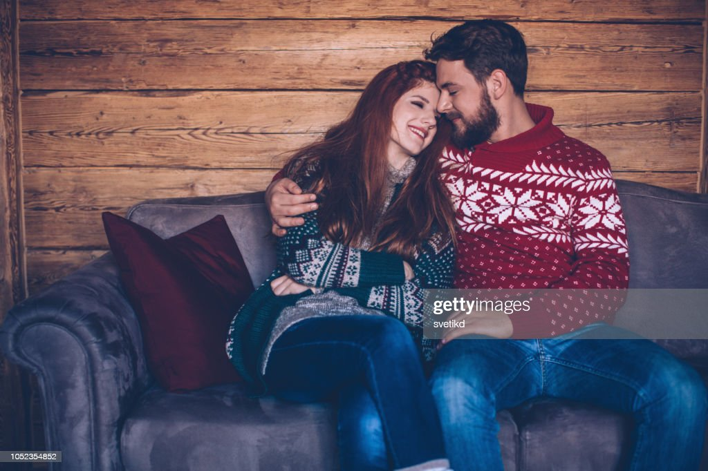 Cozy winter couple at home : Stock Photo