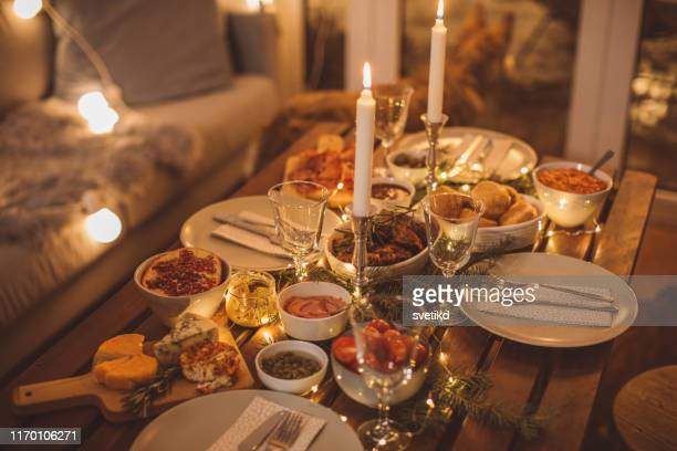 cozy winter dinner - cosy stock pictures, royalty-free photos & images