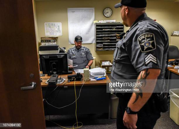 Cpl Brian Lenzner left and Sgt Justin Heschke right of Langlade county Sherriff's department begin their shift at the station on September 2018 in...