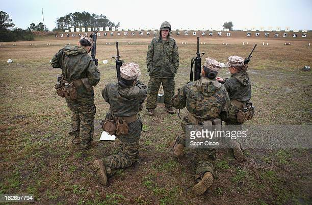 Cpl David Peck from New Market Tennessee instructs female Marines as they prepare to fire on the rifle range during boot camp February 25 2013 at...