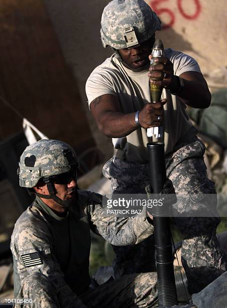 Cpt Jeff Thomasson, commander of 101st Airborne Division Alpha Battery 1-320th, prepares to fire a mortar at insurgents from Combat Outpost Nolen as...