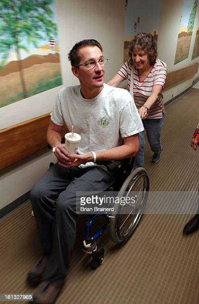 DENVER CO AUGUST 5 2004 <cq> CSU volleyball coach<cq> Andy Klussmann <cq> shuffles his feet as his mother<cq> Helen Klussman <cq>pushes him Thursday...