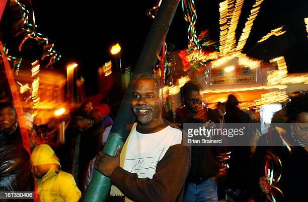 DENVER CO DEC 26 2004 <cq> Gregory Grimes <cq> joins Denver residents celebrating the first night of Kwanzaa a social holiday where people gather to...