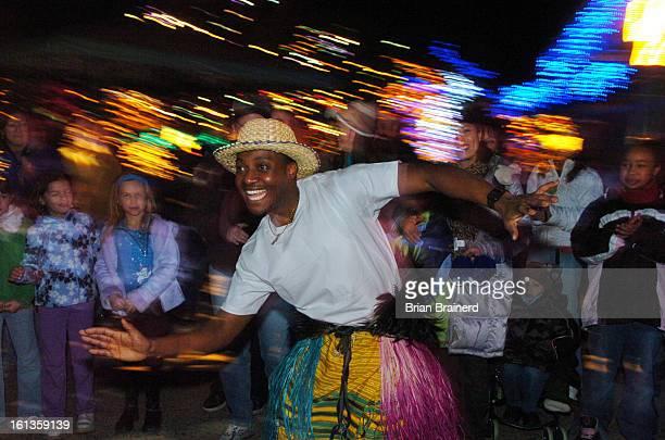 DENVER COLORADO DECEMBER 26 2005<cq> Ugandan dancer<cq> Michael Jjuuka <cq>performs a love dance on the first night of Kwanzaa Monday night at the...