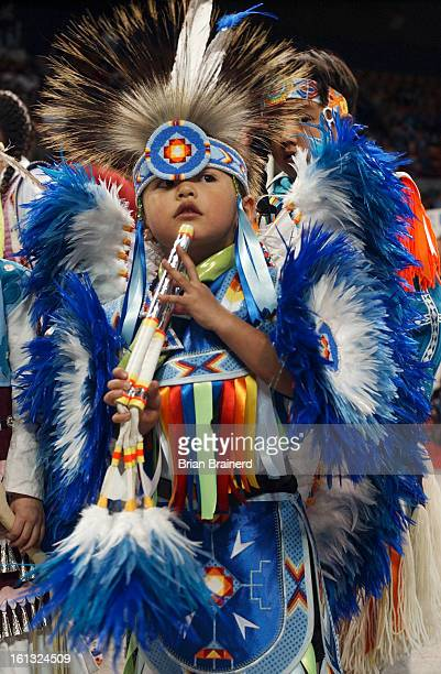 Cq>3-year-old <cq> Tate' Bear <cq> of Denver waits for his prize after dancing at the 30th Annual Denver March Powwow Sunday at the Denver coliseum....