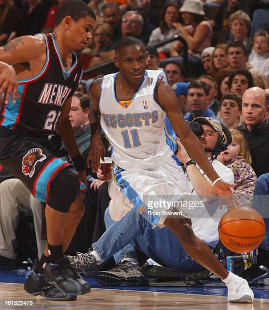 DENVER CO DEC 22 2003 <cq>First period action against Grizzlies at Pepsi Center Sunday night Earl Boykins moves the ball up the court during an...