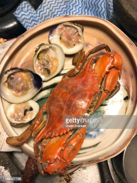 crab and clams for dinner - image stock pictures, royalty-free photos & images