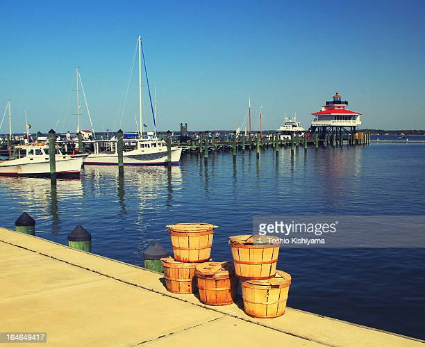 crab baskets at the choptank river lighthouse - chesapeake bay stock pictures, royalty-free photos & images