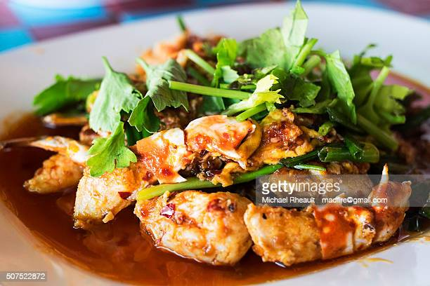 crab fried in sweet chili paste - chilli crab stock photos and pictures