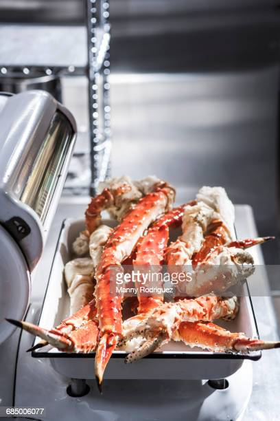 crab legs on butcher scale - crab leg stock photos and pictures