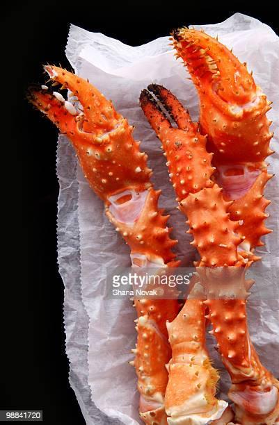 crab legs - crab leg stock photos and pictures