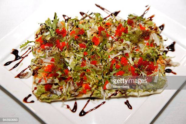 Crab pizza with green and red Tobiko crab avocado mousse wasabi olive oil and balsamic reduction is arranged for a photo at Natsumi located at 226...