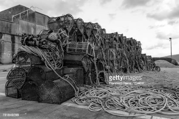 crab pots and ropes on commercial dock against sky - crab pot stock photos and pictures