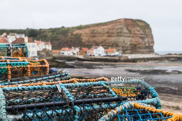 crab pots at staithes - village stock pictures, royalty-free photos & images