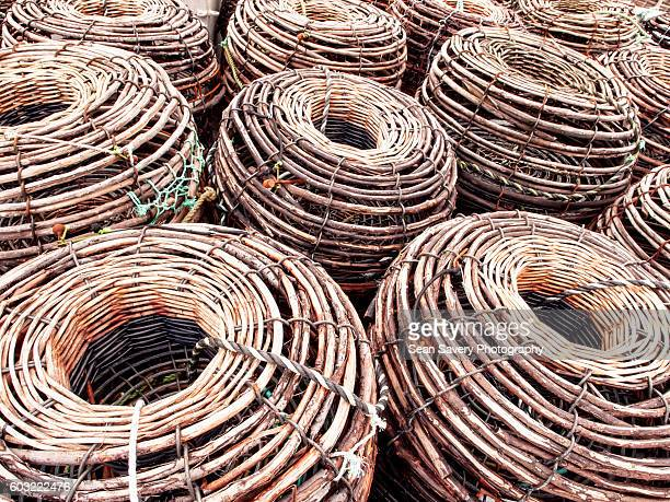 crab pots - lobster fishing stock photos and pictures