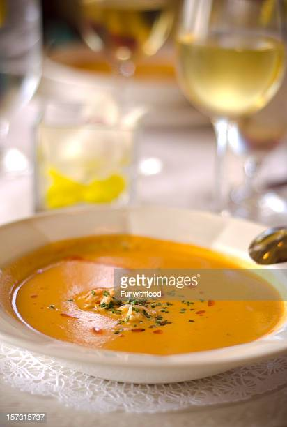 crab seafood atop pepper & tomato bisque & restaurant vegetable soup & wine - chardonnay grape stock photos and pictures
