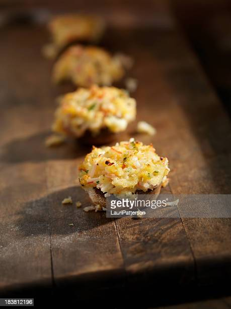 crab stuffed mushroom caps - stuffing stock photos and pictures