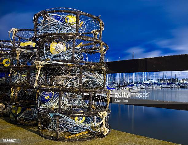 crab traps ready to go - crab pot stock photos and pictures