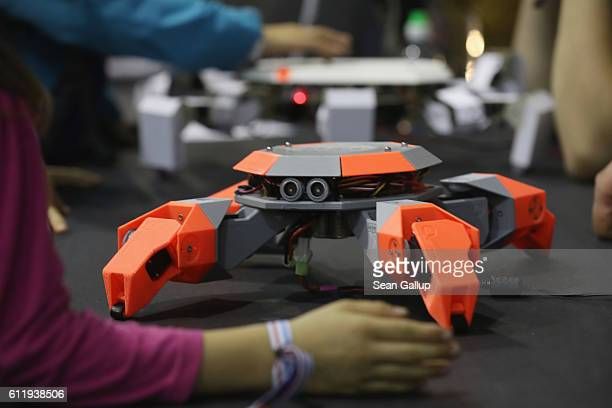 Crablike robots crawl across a table at the Zoobotics stand at the 2016 Berlin Maker Faire on October 1 2016 in Berlin Germany The Maker Faire...
