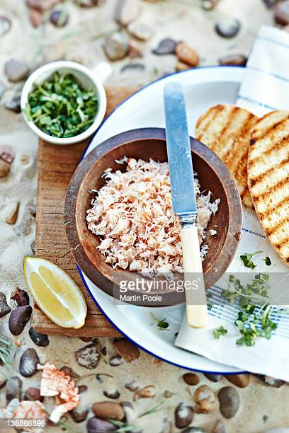 crabmeat in bow with bread on beach - crab stock pictures, royalty-free photos & images