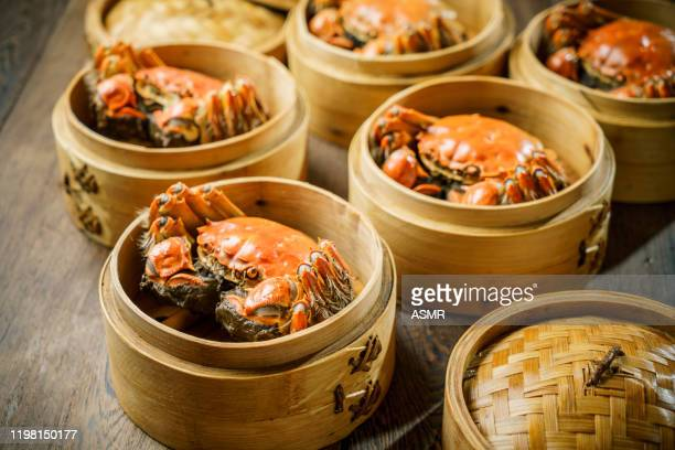 crabs on the wooden table - red lobster restaurant stock pictures, royalty-free photos & images