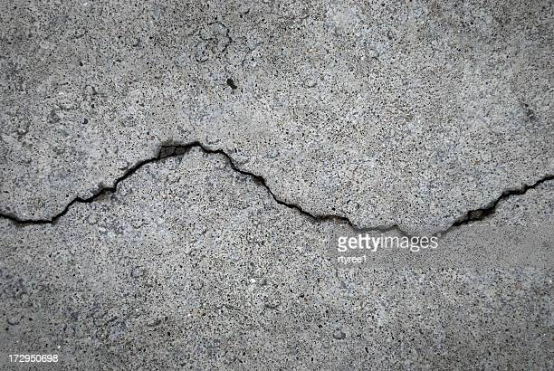 crack in grey concrete surface - pavement stock pictures, royalty-free photos & images