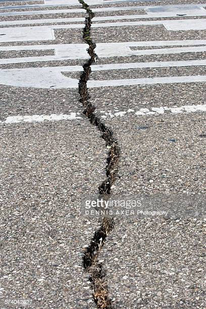 crack in road from earthquake. san andreas fault - faille de san andreas photos et images de collection