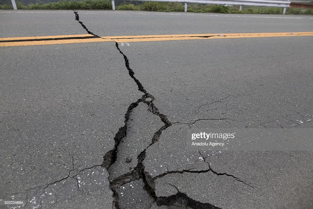 A crack road on the way to Minamiaso town is seen on April 18, 2016 in Minamiaso, Kumamoto, Japan. After the magnitude 7.3 earthquake hit Kyushu at least 42 people have died and 11 still missing.