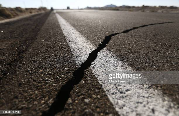 Crack stretches across the road after a 6.4 magnitude earthquake struck the area on July 4, 2019 near Ridgecrest, California. The earthquake was the...