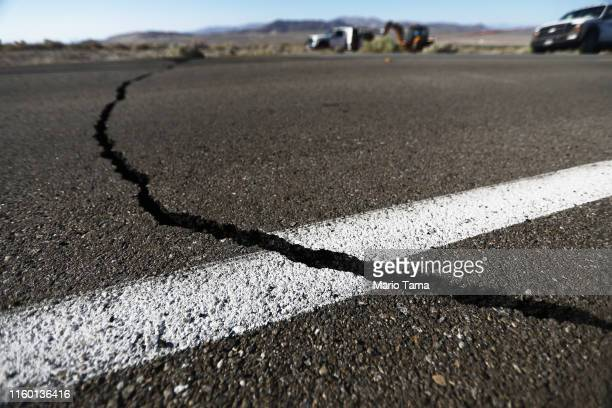 A crack stretches across the road after a 64 magnitude earthquake struck the area on July 4 2019 near Ridgecrest California The earthquake was the...