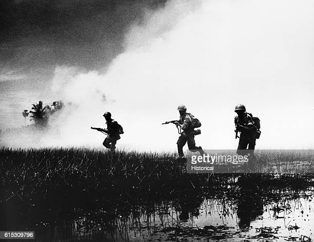 Crack troops of the South Vietnamese Army in combat operations against the Communist Viet Cong guerillas Swampy terrain of the delta country makes...
