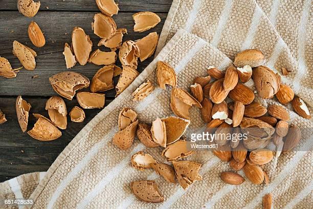 Cracked almonds on kitchen towel