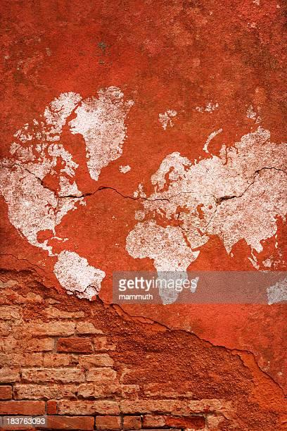 cracked and damaged world map on brick wall